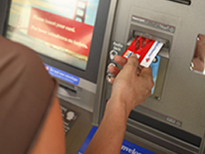 An ATM Being Used by a Person